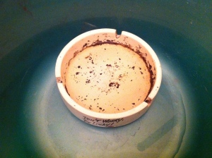 an ashtray soaking in a basin