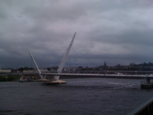 the sloping spires of the peace bridge across the river foyle
