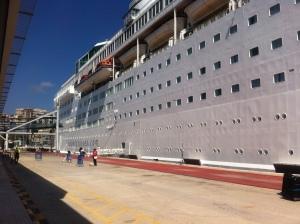 the huge bulk of the cruise ship, Island Escape
