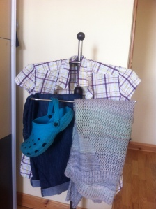 Blue crocs, checked short-sleevd shirt (Craghoppers), denim cropped trousers, lightweight green jumper (Warehouse)