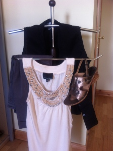Bronze wedges, cream top with beaded neckline, black sleeveless shirt, grey crops.
