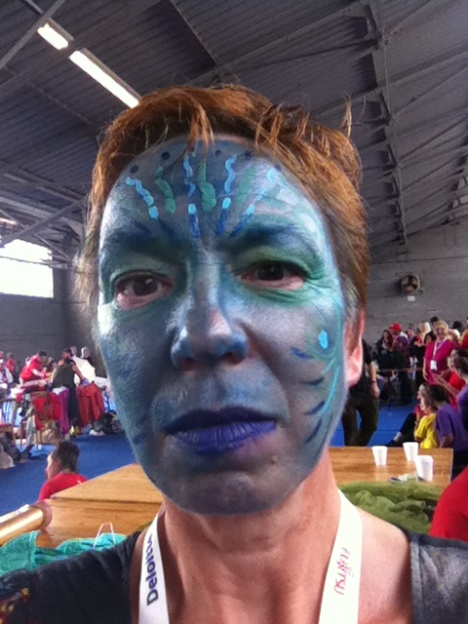 Someone wearing blue face paint, but not a Smurf